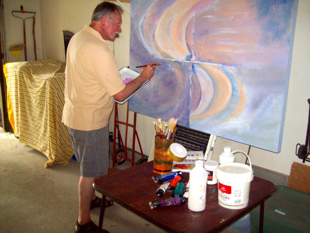 Artist, Richard Burton painting in his garage.